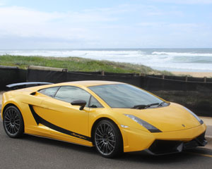 Drive a Lamborghini Gallardo, Beach Cruise PLUS Passenger Rides For Free - Newcastle
